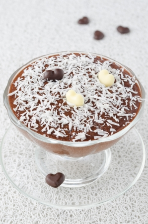 chocolate mousse with chocolate hearts in a glass sundae dish decorated with coconut photo