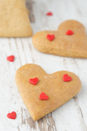 cookies in the shape of a heart on the table, closeup, scattered sugar hearts Stock Photo - 17295400
