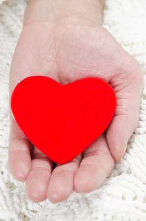red heart in the palm of a man's closeup Stock Photo - 17295396