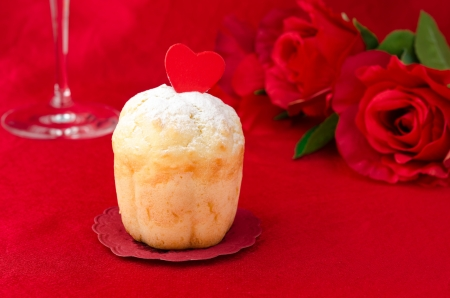 rum baba: Rum Baba decorated with hearts and roses in the background