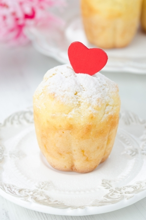 rum baba: Rum Baba decorated with red hearts and topped with powdered sugar on a plate