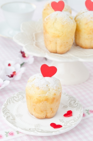 rum baba: Rum Baba decorated with red hearts on a plate  Stock Photo