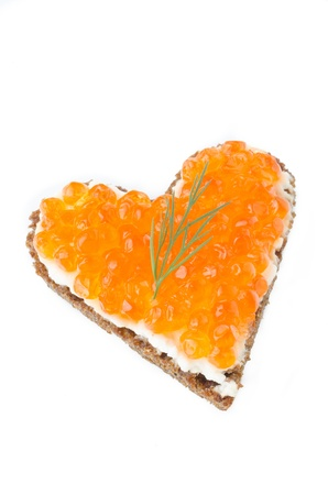 sandwich with red caviar in the form of a heart  isolated on a white background photo