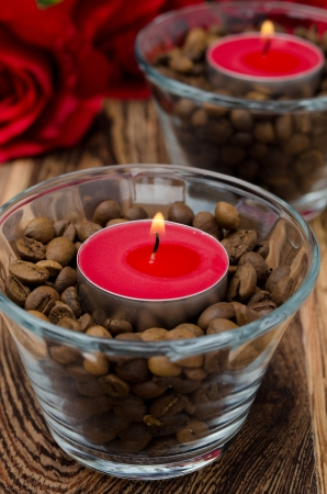 red candles in glass jars with coffee beans for Valentine photo