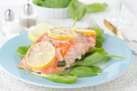 Baked salmon fillet with lemon and spinach photo