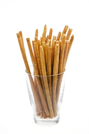 breadstick: Bread sticks with salt in a glass beaker isolated on a white background Stock Photo