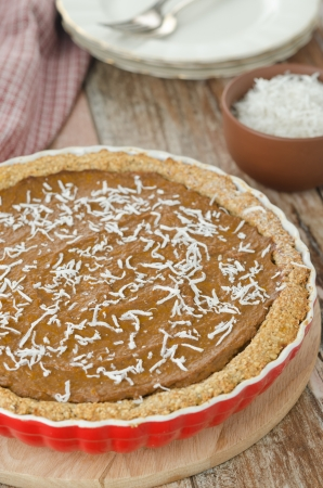 Pie with pumpkin and chocolate in ceramic form on a wooden table Stock Photo - 17513004
