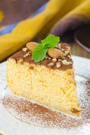 piece of pumpkin cheesecake on a white plate Stock Photo - 17640102