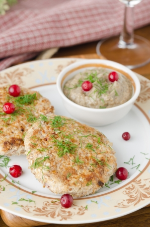 Chicken cutlets with cowberry and mushroom sauce  photo