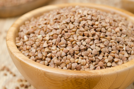 Raw buckwheat in a wooden bowl horizontal closeup Stock Photo - 17973165