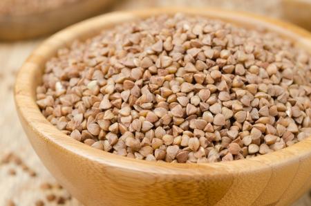 Raw buckwheat in a wooden bowl horizontal closeup Stock Photo - 17973165