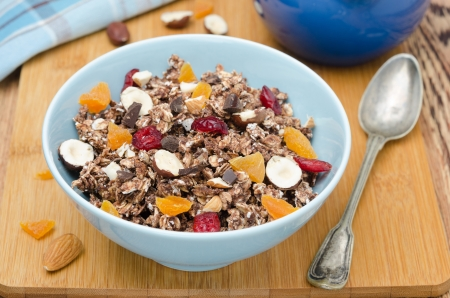 Chocolate granola with nuts and dried fruit on a wooden board horizontal  Stock Photo - 18349433