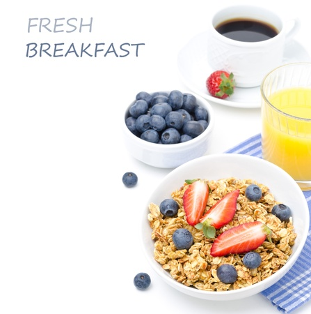 breakfast with homemade granola and fresh berries, orange juice and black coffee isolated on a white background photo