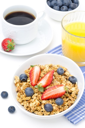 breakfast with homemade granola and fresh berries, orange juice and coffee  photo