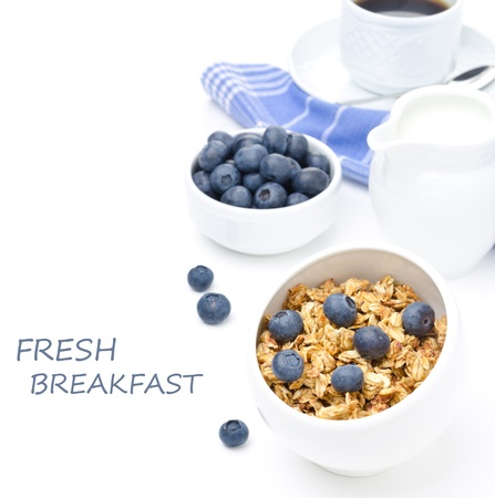 breakfast with homemade granola, blueberries and black coffee isolated on a white background photo