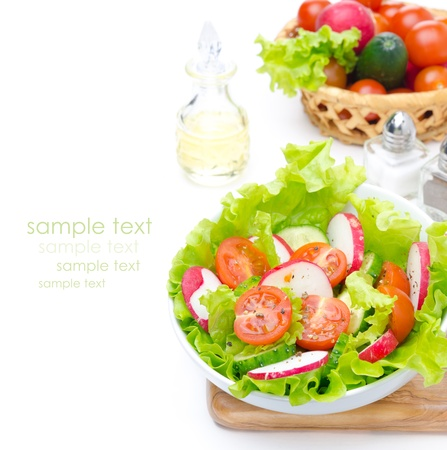 salad with fresh vegetables and ingredients for salad isolated on a white background, top view photo