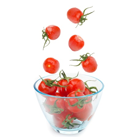 bowl of cherry tomatoes isolated on white background photo
