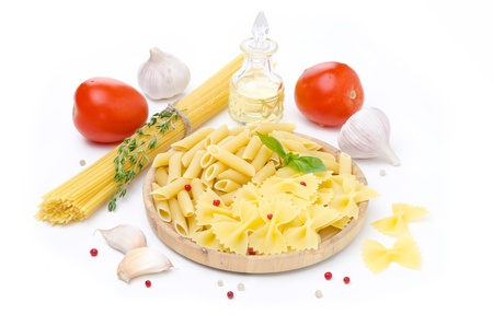 different kinds of Italian pasta, fresh tomatoes, olive oil and spices, horizontal, isolated on a white background photo
