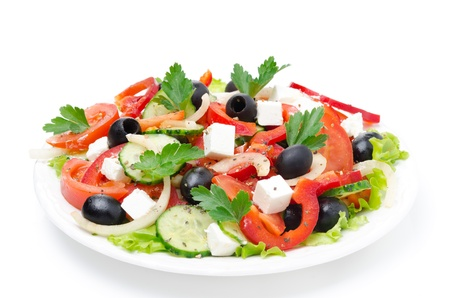 mediterranean cuisine: Greek salad with feta cheese, olives and vegetables, isolated on a white background