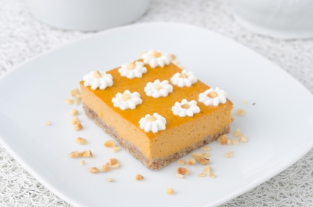 Pumpkin cake, decorated with flowers made of whipped cream and nuts Stock Photo - 18903594