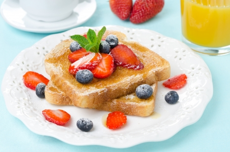 crispy toast with honey and fresh berries for breakfast closeup photo