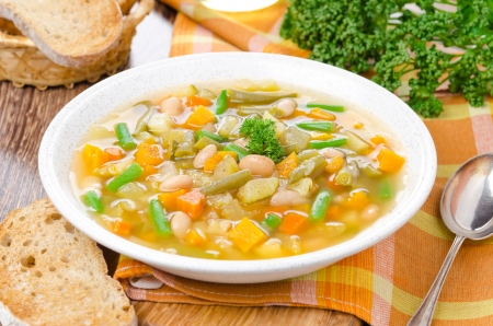 minestrone: plate of vegetable minestrone with white beans and toast