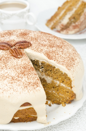 carrots and pumpkin cake with coffee cream in a cut closeup photo