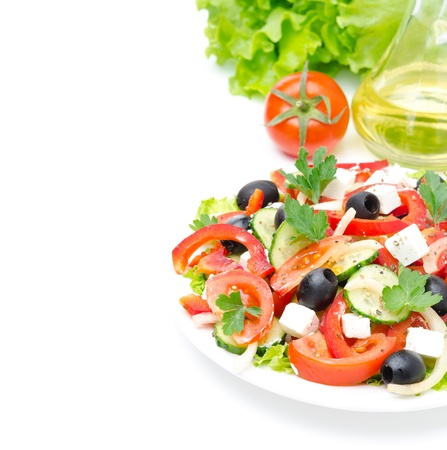 Greek salad with feta cheese, olives and vegetables isolated on a white background with sample text Foto de archivo