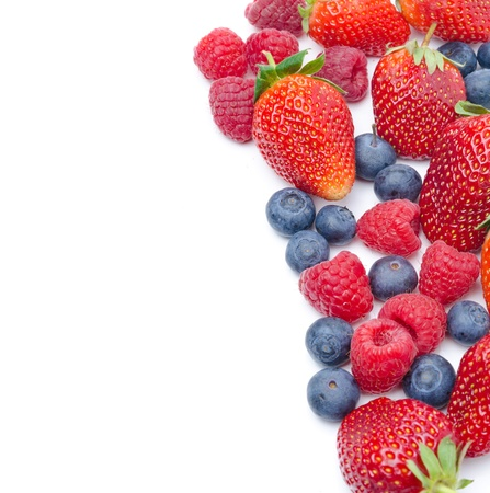 assorted fresh berries isolated on a white background