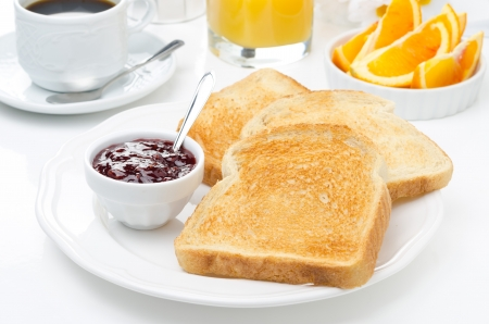bread slice: breakfast with toasts, jam, coffee and orange juice closeup Stock Photo
