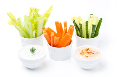 assorted fresh vegetables and two yogurt sauce isolated on a white background photo