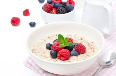 porridge: healthy breakfast - oatmeal with fresh berries Stock Photo