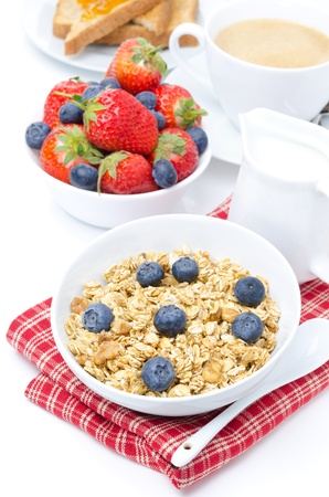 homemade muesli with fresh berries for breakfast, isolated on white photo