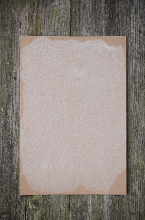 empty sheet of paper for recipe on the old wooden background, closeup photo