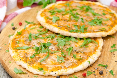 chicken pizza with tomato sauce, cheese and parsley, horizontal close-up photo