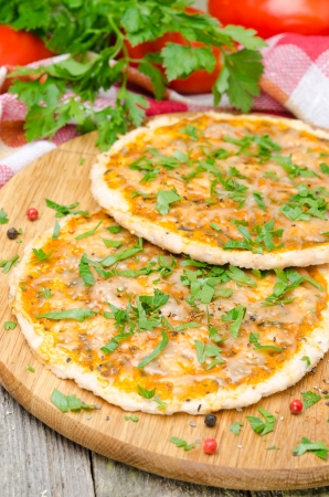 chicken pizza with tomato sauce, cheese and parsley, vertical photo