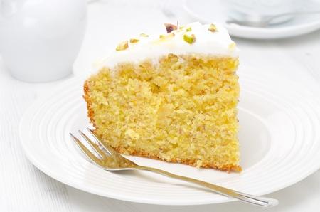 piece of cake: piece of orange cake decorated with Greek yogurt, honey and pistachios Stock Photo
