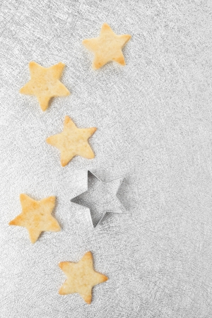 Christmas cookies star on a silver background, top view