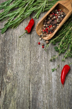 Spices and herbs on a wooden background  and space for text , top view