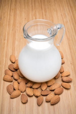 Glass jug with almond milk, top view photo