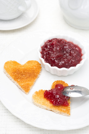 toast in the shape of hearts and berry jam, close-up photo