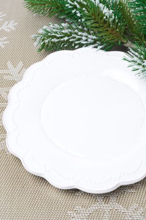 Christmas table setting with an empty plate (and space for text) photo