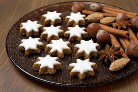 Christmas cookies and spices on a plate, close-up, horizontal photo