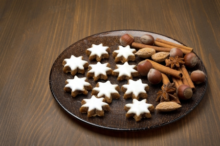 Christmas cookies and spices on a plate, horizontal photo