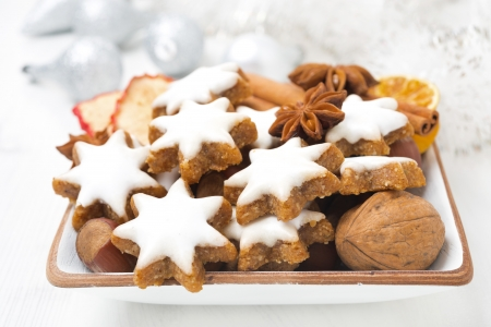 Christmas cookies in the form of stars, nuts and spices, close-up, horizontal photo