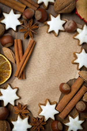 sheet of paper for recipe, Christmas cookies and spices, top view photo