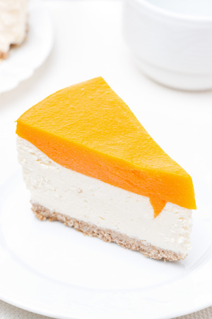 piece of cheesecake with pumpkin jelly, vertical, top view photo