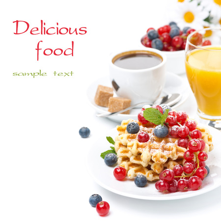 delicious breakfast with waffles, berries, orange juice and coffee, isolated on white photo