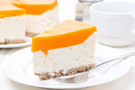 piece of cheesecake with pumpkin jelly, horizontal photo