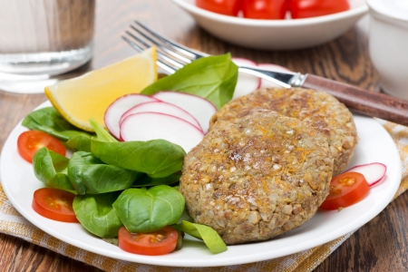 vegetarian burgers made from lentils and buckwheat on the plate, close-up Reklamní fotografie